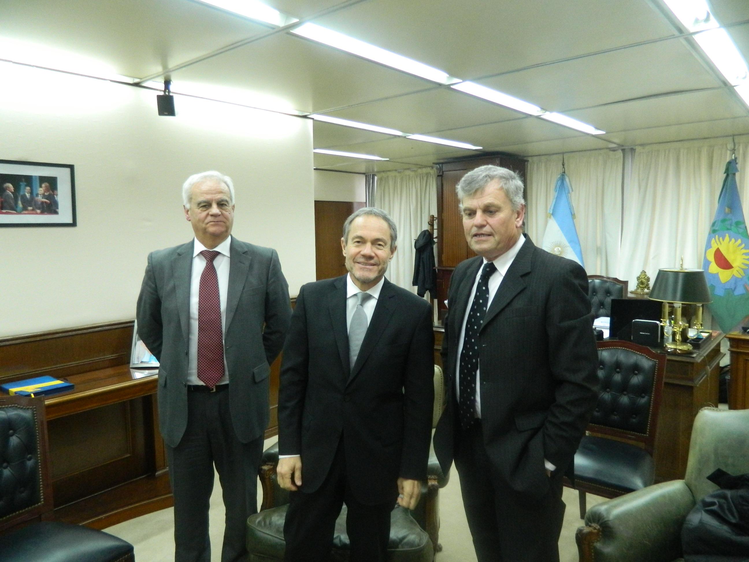 Gentile, Ferrai y Honores, al término de la reunión en el ministerio de Justicia.